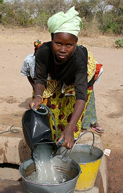 buildon-woman-getting-water-for-the-work-site