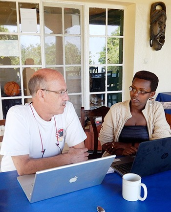 Darrell Johnson working with Village Health Works' Budget Manager
