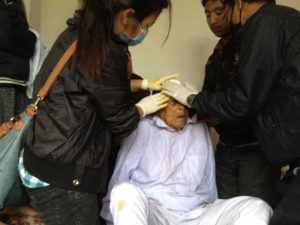 The- Adara medical team provide emergency first aid to a-gentleman with a head wound in Shankhu