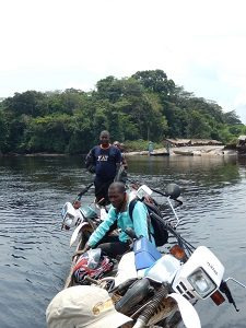 """A typical """"multi-transit"""" scenario…carrying motorcycles by canoe"""