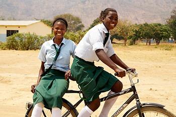 Kids on bike.