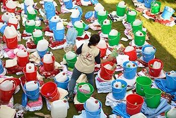 A Mercy Corps team member prepares emergency kits to distribute in Kathmandu, Nepal following the devastating earthquake in April 2015.