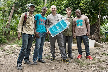 PotaVida_World Concern field staff in Haiti with Tyler and Charlie