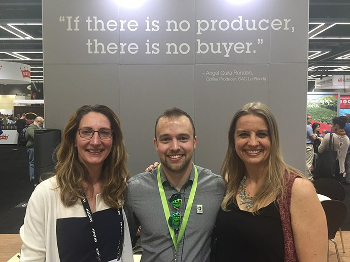 Kristen Daily, Executive Director of Global WA; Parker Townley, Business Development Manager, Fair Trade USA; Erika Koss, Northeastern University at the Fair Trade USA booth at the 2017 Global Specialty Coffee Expo. (Photo: provided by Erika Koss)