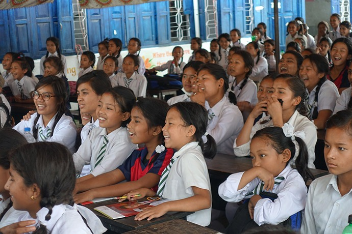 Young women react to an interactive presentation about menstrual health at Adarsha Kanya School in Lalitpur District, Nepal, on Menstrual Hygiene Day, May 28, 2017. (Credit: Splash)