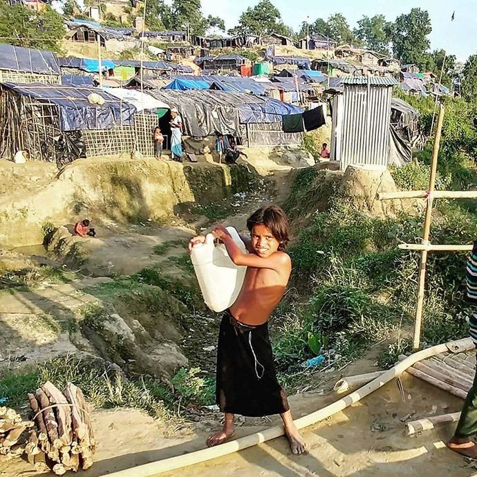 Youth with water jug Rohinga