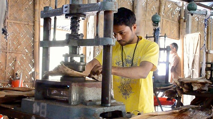 22-year-old Tanjit Pathak, from Barpeta, Assam, prepares an arecanut palm leaf on a heated mold. The leaf will be turned into biodegradable dinnerware.