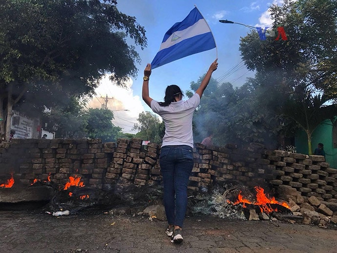 Woman with flag at Nicaraguan protests