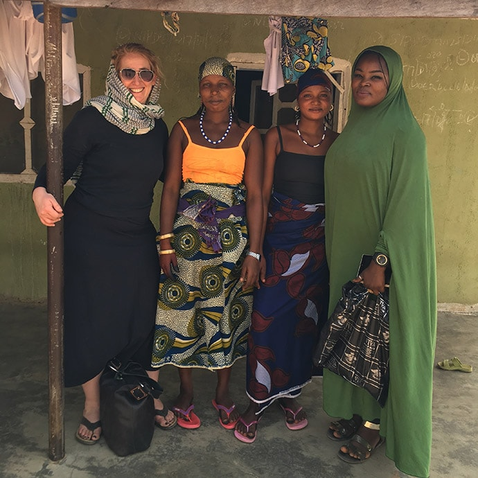 Rebecca Wolfe (left) stands beside community members in Nasarawa state, Nigeria