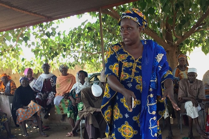 A woman in Sido, Mali, explains to the mayor why formal marriages are necessary to protect women from abandonment