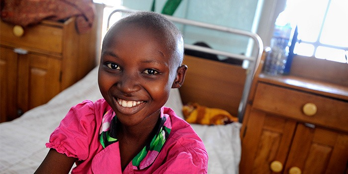 Grace Mbabazi, 12-years-old, undergoing treatment for Burkett lymphoma, at Uganda Cancer Institute. Photo by Jacqueline Koch for Fred Hutch.