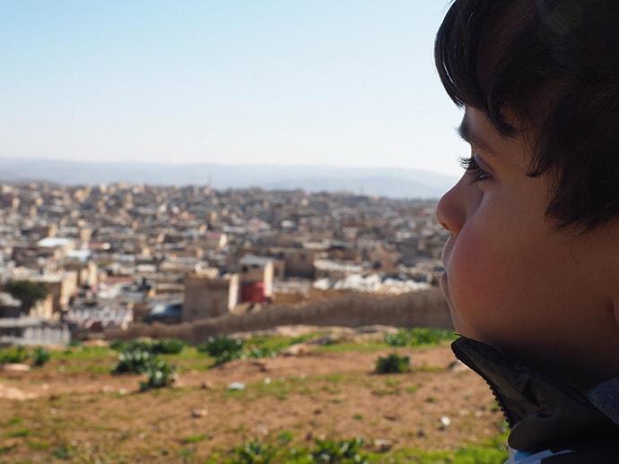 Child overlooking refugee camp in Jordan