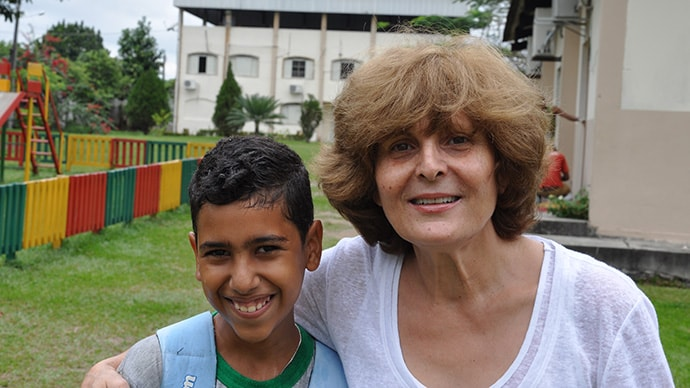 Mahnaz Javid poses with a student at The Association for Cohesive Development of the Amazon (ADCAM)