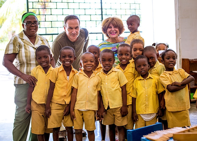 Mahnaz Javid poses with students and faculty of the Zunuzi school in Haiti