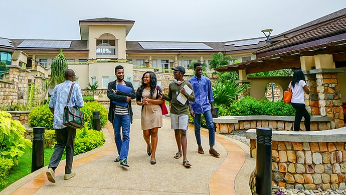 Students walk across the Ashesi University campus