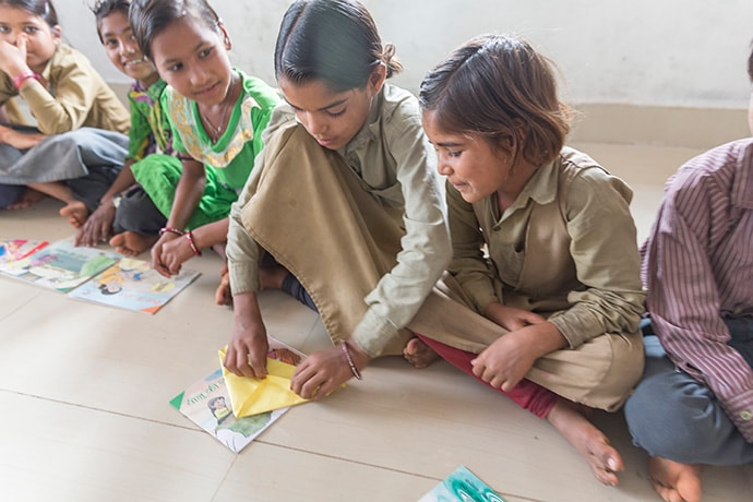 Students in reading camps make reading materials in World Vision India's Literacy Boost program