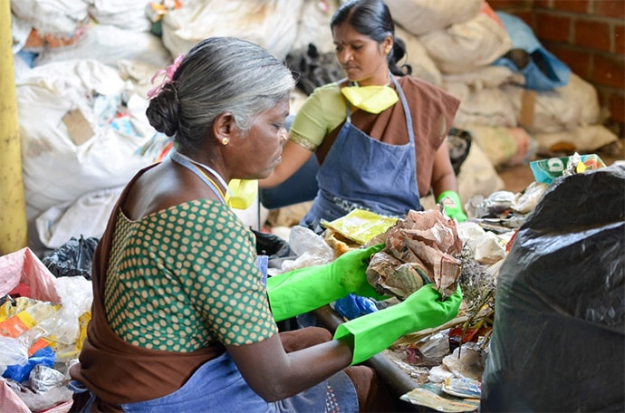 Employees sort waste at a Saahas Waste Management facility outside Bangalore, India
