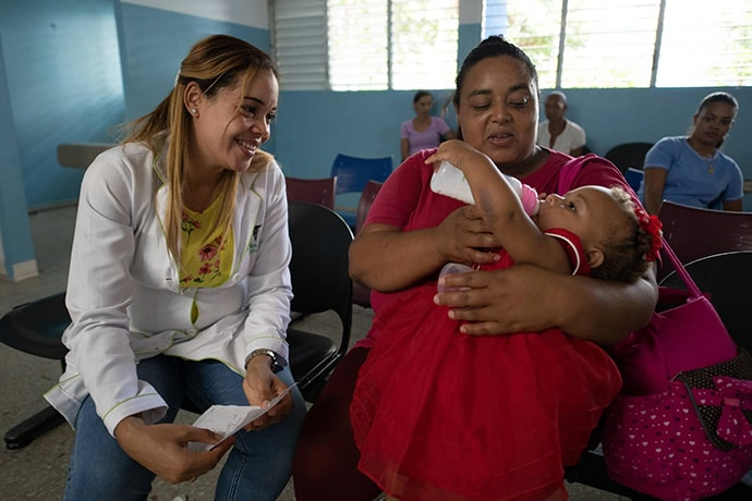 A mother and baby receive care at the Tamboril Municipal Hospital in the Dominican Republic
