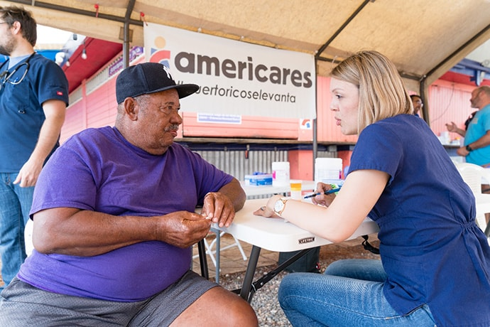 A patient receives care at an Americares mobile clinic for Hurricane Maria survivors