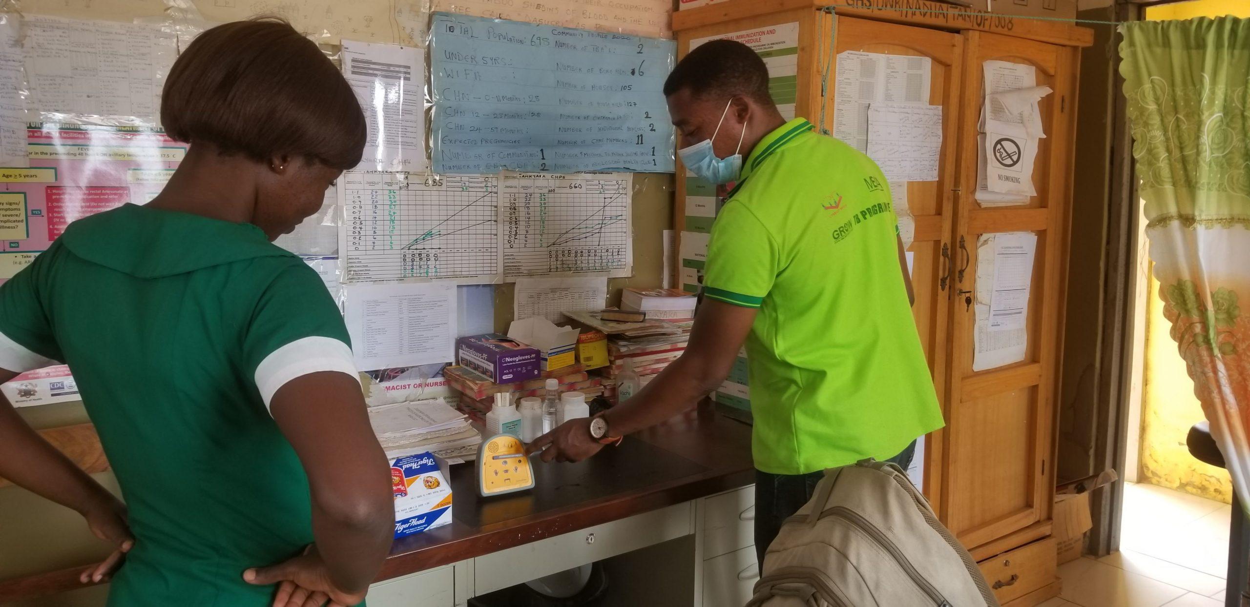A Literacy Bridge Ghana staff member trains a community health nurse on using Amplio's Talking Book for the COVID-19 response. Credit: Amplio.