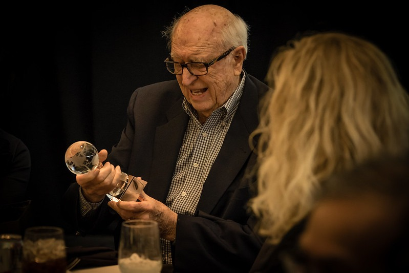 Bill Gates Sr. holding the Global Hero award, presented by Global Washington on December 10, 2015.