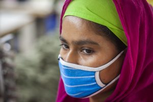 An apparel worker in Dhaka wears a face covering and maintains social distance from other workers as garment factories reopened amid the Covid-19 pandemic. Photo: UN Women/Fahad Abdullah Kaizer via Flickr.