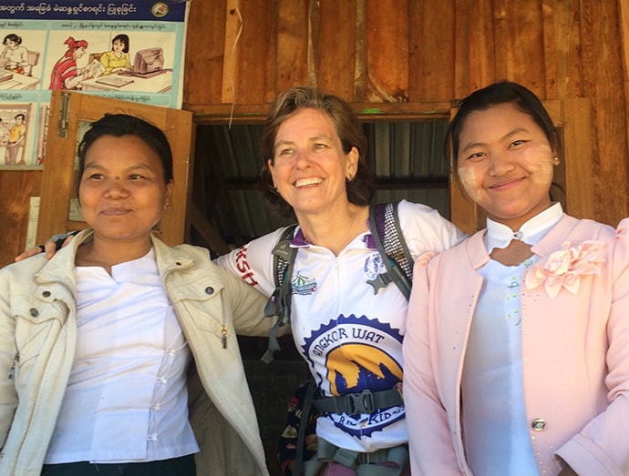 Therese Caouette, center, poses with teachers from a village school in Chin State, while on a bike trip with Partners Asia in western Myanmar. A longtime Seattle resident, Caouette plays a critical role in shaping Partners Asia and advocating for trust-based philanthropy. Photo credit: Tim Schottman/Partners Asia.