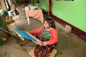 Ana practicing traditional weaving
