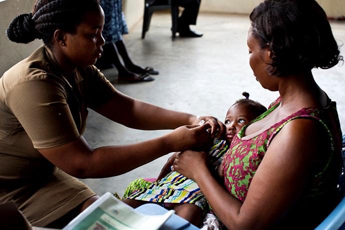 Nurse vaccinates baby