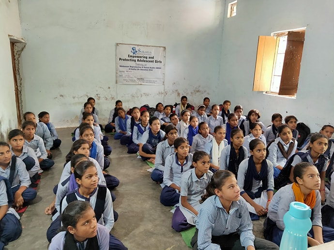 Students in uniform sitting in classroom