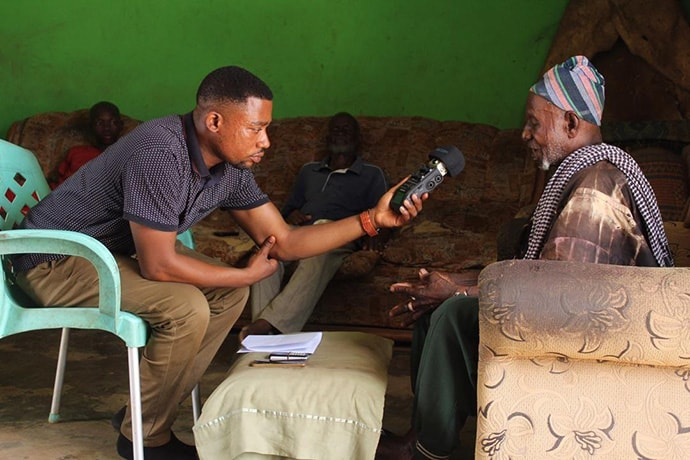 Toffic Dapilaah, MEAL/Partnership Development Officer, Amplio Ghana, records an endorsement message from a traditional leader