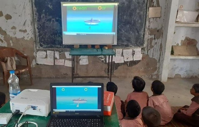 Students watching screen in classroom