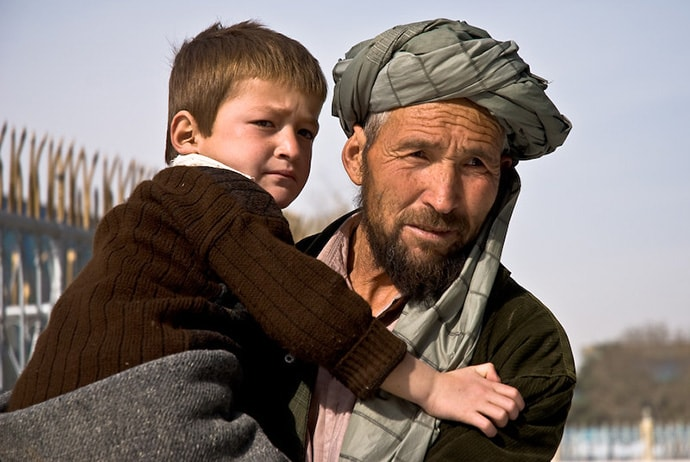 Man holding child in afghanistan