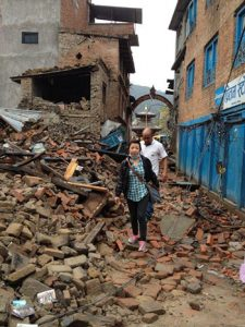 Menuka-Adaras-Health-and-Medical-Coordinator-climbs-over-rubble-to-deliver-health-services-350pxW