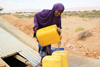 Woman pouring water.
