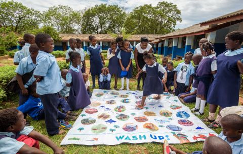 WorldVision-Ngonga-on-Story-Mat