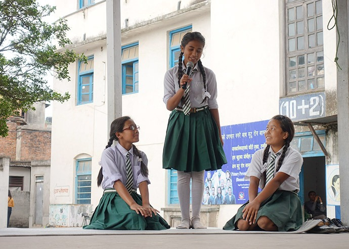 Female student leaders give speeches to their classmates about hygiene education at Adarsha Kanya School in Lalitpur District, Nepal, on Menstrual Hygiene Day, May 28, 2017. (Credit: Splash)