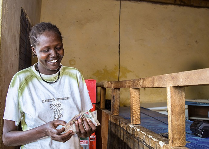 Catherine Nabulon, 34, of Abulon, Kenya, uses her E-wallet to procure safe drinking water for her family