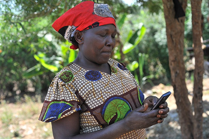 Digital technology helps farmers like Theresia Wairuba receive and repay loans via mobile phones.