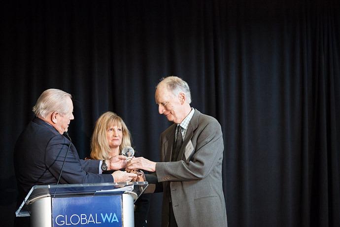 Tom Waldron accepts award