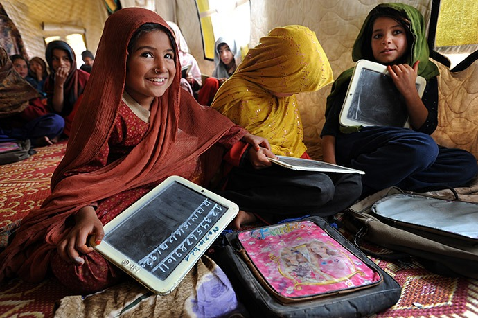 Girls study math in an IRC-run school in Pakistan's Jalozai camp, home to almost 10,000 people displaced by fighting between the Pakistani army and the Taliban